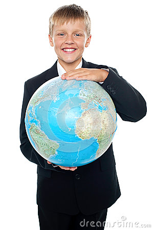Cheerful boy in suit holding globe with both hands