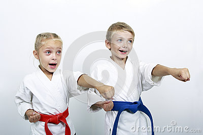 Cheerful brother and sister athletes a punch arm