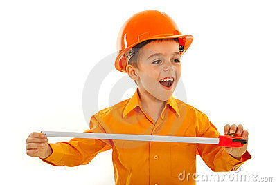 Cheerful builder kid looking away