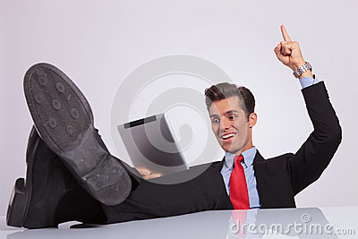 Cheerful business man pointing up