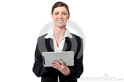 Cheerful business manager holding touch pad