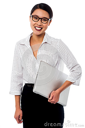 Cheerful business mananger posing with laptop