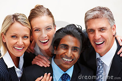 Cheerful business people smiling on white