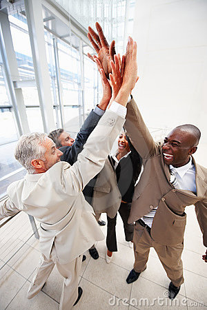 Cheerful business team with their hand raised