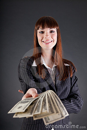 Cheerful business woman with dollars