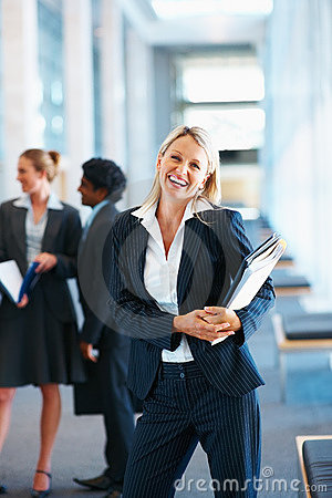 Cheerful business woman holding files