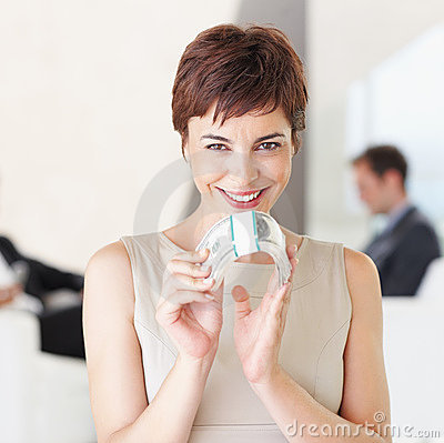 Cheerful business woman holding money