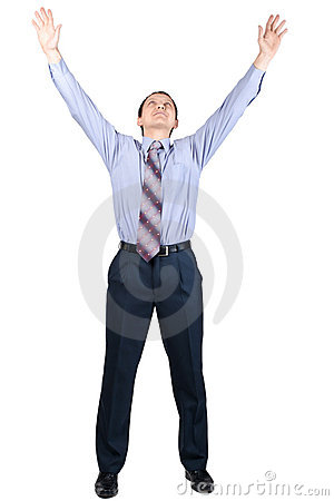 Cheerful businessman with hands raised in victory