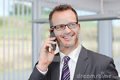 Cheerful businessman having a phone conversation