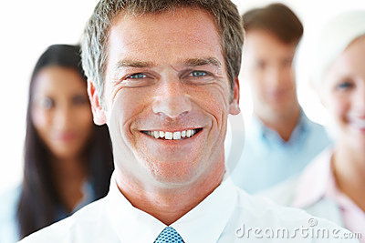 Cheerful businessman leading his successful team