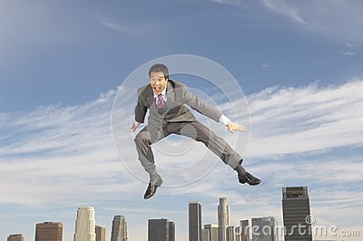 Cheerful Businessman In Midair