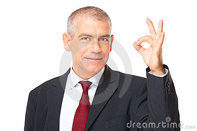 Cheerful businessman with ok sign