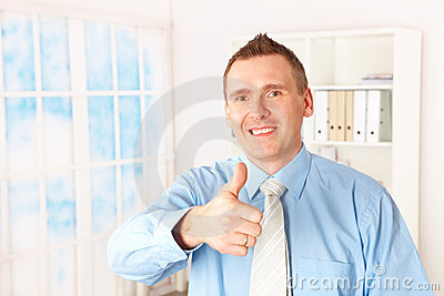 Cheerful businessman with a thumbs up sign
