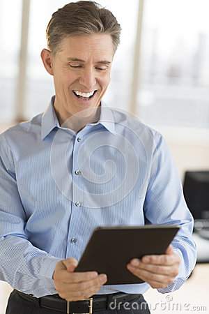 Cheerful Businessman Using Digital Tablet