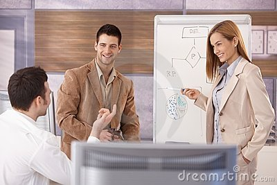 Cheerful businessteam working together smiling