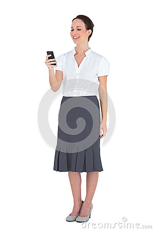 Cheerful businesswoman holding her phone