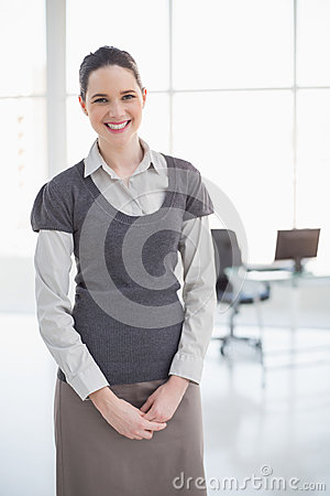 Cheerful businesswoman posing