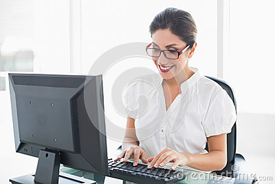 Cheerful businesswoman working at her desk