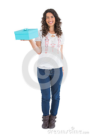 Cheerful casual brunette holding a present