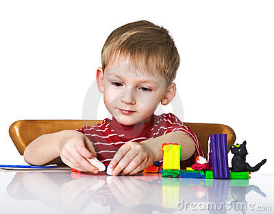 Cheerful child with plasticine