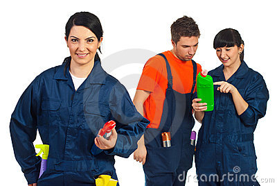 Cheerful cleaning worker woman and her team