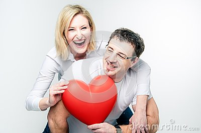 Cheerful Couple with big Heart