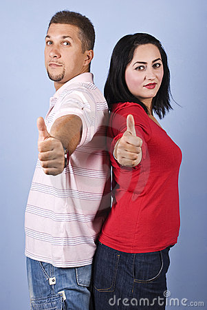 Cheerful couple give thumbs up