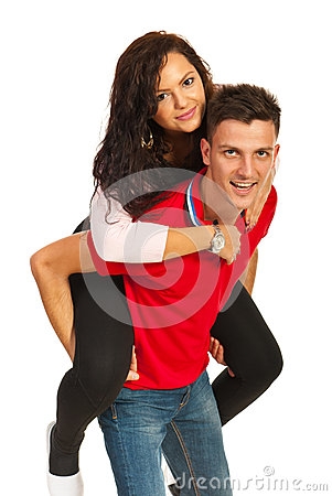 Cheerful couple in piggy back