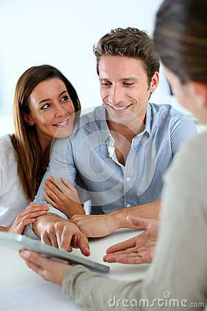 Cheerful couple ready to buy a house