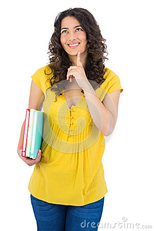 Cheerful curly haired student holding notebooks