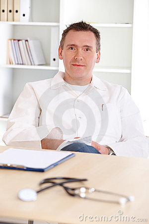 Cheerful doctor sitting in office