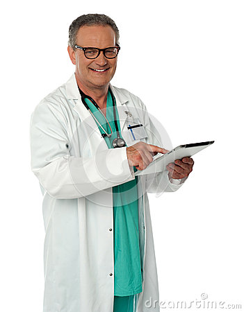Cheerful doctor using wireless tablet device