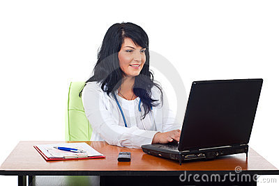 Cheerful doctor woman using laptop