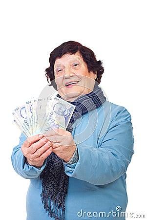 Cheerful elderly holding money