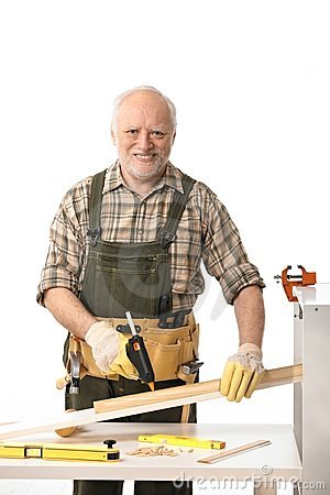 Cheerful elderly man tinkering