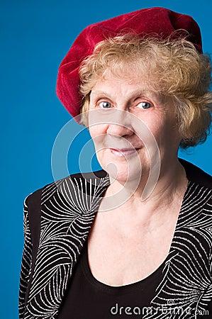 The cheerful elderly woman.