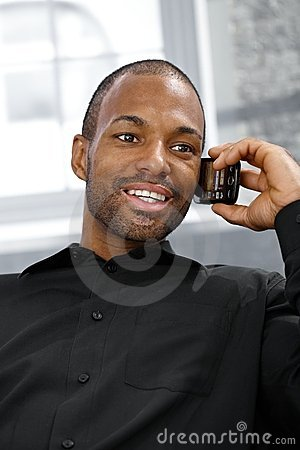 Cheerful ethnic man on phone call