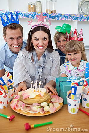 Cheerful family celebrating mother s birthday