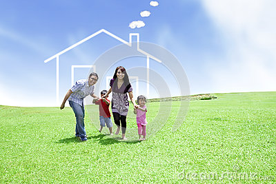 Cheerful family with a drawn house
