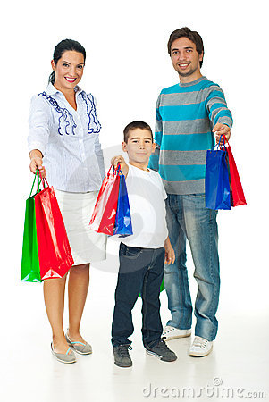 Cheerful family giving shopping bags