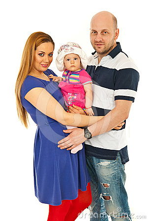 Cheerful family holding baby