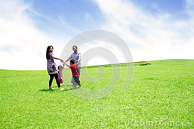 Cheerful family playing outdoor