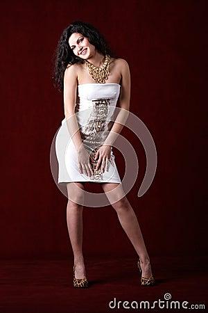Cheerful fashion model wearing short white dress