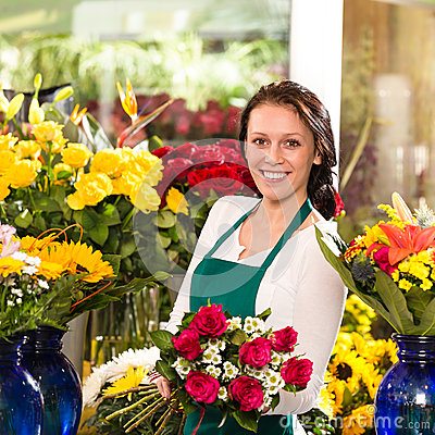Cheerful female florist bouquet roses flower shop