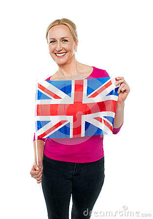 Cheerful female supporter holding national flag