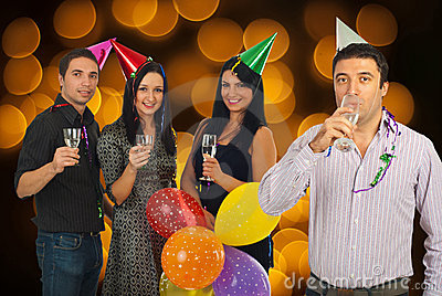 Cheerful friends celebrating New Year s Eve