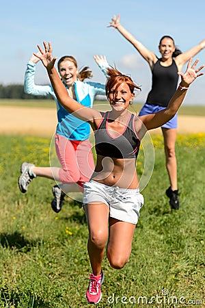 Cheerful friends jumping enjoy summer sport run