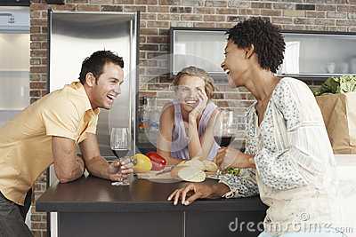 Cheerful Friends At Kitchen Counter