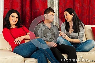Cheerful friends on sofa