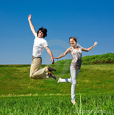 Cheerful girl and boy are jumping